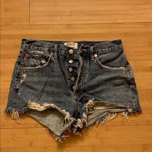Agolde cut off shorts in darker wash.
